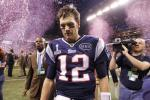 New England Patriots quarterback Tom Brady leaves the field after their loss to the New York Giants in the NFL Super Bowl XLVI football game in Indianapolis, Indiana