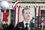 A Russian and a Chinese flag hang from a balloon during a rally of supporters of Syrian President Bashar al-Assad at al-Sabaa Bahrat square in Damascus