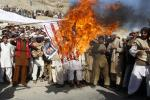Afghan protesters burn a U.S. flag during a protest in Jalalabad province February 24, 2012.