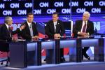 U.S. Republican presidential candidate Paul speaks as Santorum, Romney and Gingrich listen during the Republican presidential candidates debate in Mesa