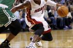Dwayne Wade looks for an opening against Rajon Rondo.