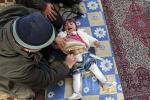 Syrian refugee beign treated by doctor