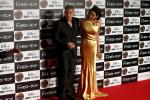 """Cast member George Clooney (L) poses with his wife Amal on the red carpet during the Japan premiere of the movie """"Tomorrowland"""" in Tokyo"""
