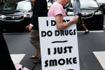 PHILADELPHIA, PA - JULY 28: A woman walks with a sign supporting legalizing marijuana during the Democratic National Convention (DNC) on July 28, 2016 in Philadelphia, Pennsylvania.