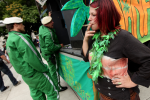 BERLIN - AUGUST 07: A young woman smokes a legal herb called damian as policemen stand nearby prior to marching in support of the legalization of marijuana in Germany during the annual Hemp Parade