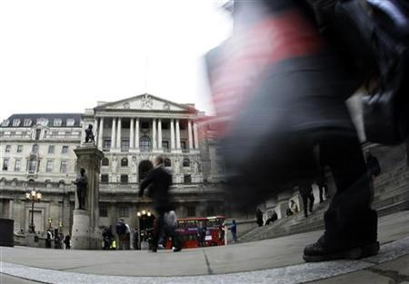Pedestrians walk past Britain's Bank of England in London