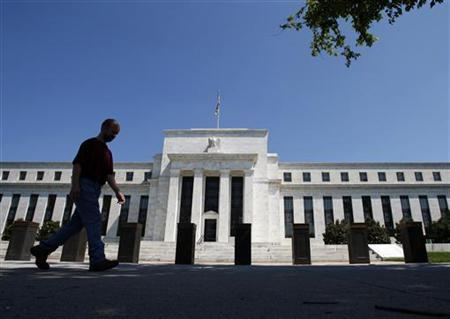 A man walks in front of the U.S. Federal Reserve building in Washington