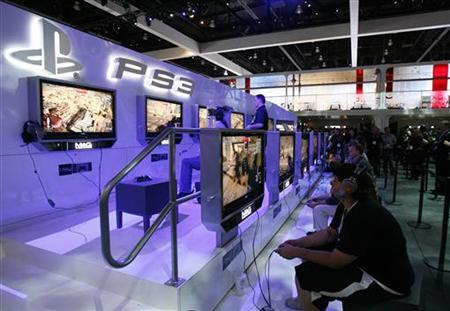 Visitors play the Sony video game MAG for PlayStation 3 during the Electronic Entertainment Expo or E3 in Los Angeles