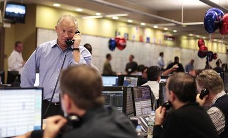 Brokers trade over the phone on the dealing floor at ICAP in Jersey City, New Jersey