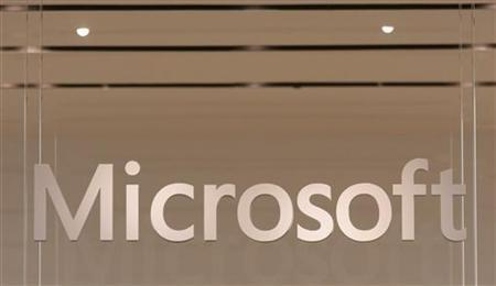 The Microsoft logo hangs from a window during the grand opening of Microsoft's first retail store in Scottsdale