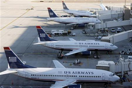 US Airways aircrafts sit outside terminal 4 at Phoenix Sky Harbor International Airport in Phoenix