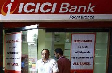 A man leaves an automated teller machine (ATM) facility of ICICI bank in Kochi