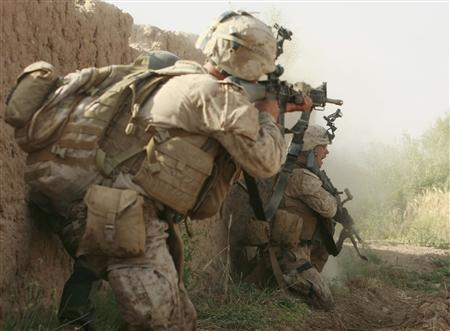 U.S. Marines from Lima Company 3rd Battalion, 6th Marines return fire during a shootout with Taliban fighters in Karez-e-Sayyidi, in the outskirts of Marjah district