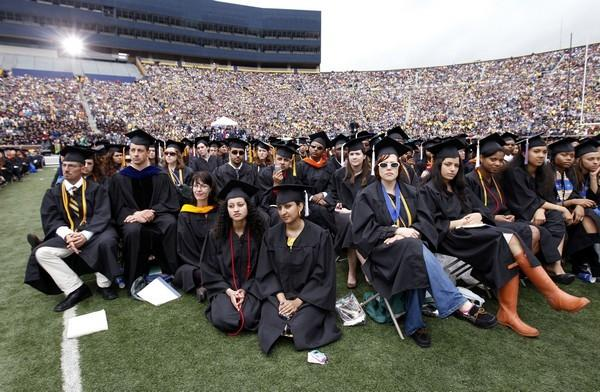 Graduating students listen to U.S. President Barack Obama speak at the University of Michigan commencement ceremony in Ann Arbor, Michigan May 1, 2010. The government is increasing its Pell Grant program and making loans directly.