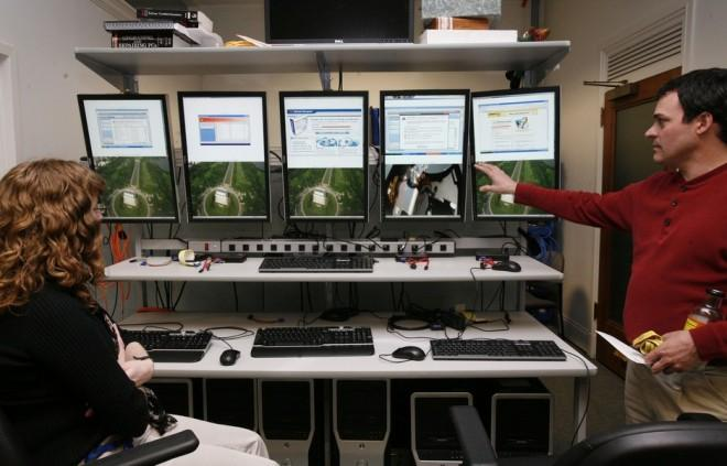 Investigators with the Federal Trade Commission look at computer monitors in the FTC internet lab where cyber crime investigations take place, in Washington March 22, 2010.