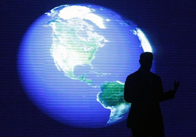 A silhouette shot of Al Gore, a U.S. former vice-president and Nobel Peace Prize Laureate, is seen in front of a monitor during his lecture on climate change inside a mall in Manila June 8, 2010.