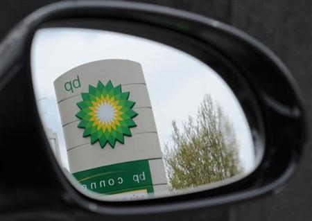 A British Petroleum logo is seen reflected in a car mirror at a petrol station in south London