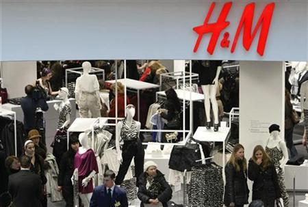 People shop in the newly opened Hennes & Mauritz (H&M) store in Moscow