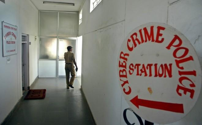 An Indian policeman walks down at the cybercrime police station in the southern Indian city of Bangalore October 16, 2006