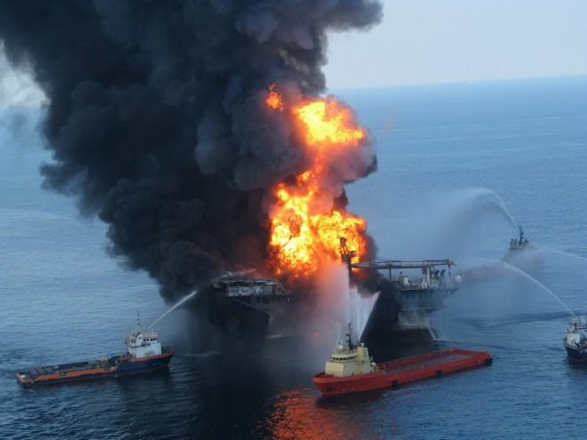 Fire boat response crews battle the blazing remnants of the offshore oil rig Deepwater Horizon, off Louisiana, in this handout photograph taken on April 21, 2010 and obtained on April 22.