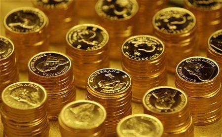 Gold bullion coins known as Krugerrands are pictured in the mint where they are manufactured in Midrand outside Johannesburg
