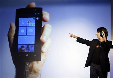 "Microsoft's Vice-President for Windows Phone Program Management Joe Belfiore gestures during the ""Windows phone 7"" presentation"