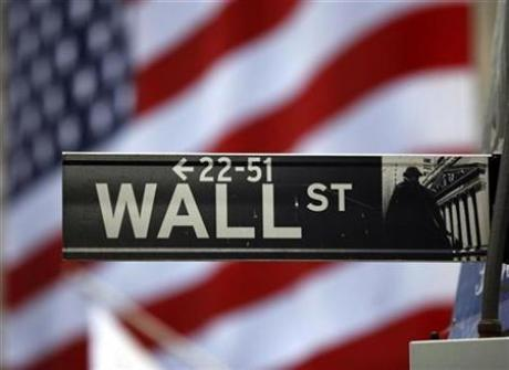 The Wall Street sign is seen outside the New York Stock Exchange, March 26, 2009.