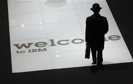A man visits stand of US firm IBM at CeBIT computer fair in Hanover