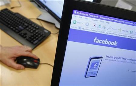 A Facebook page is displayed on a computer screen