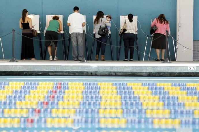 Voters cast their votes at the Echo Park Deep Pool being used as polling place in Los Angeles