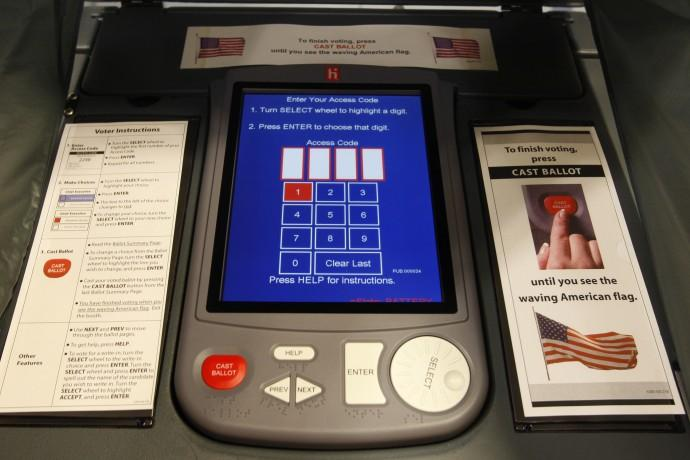 An electronic voting booth is seen in a polling station in Alexandria, Virginia