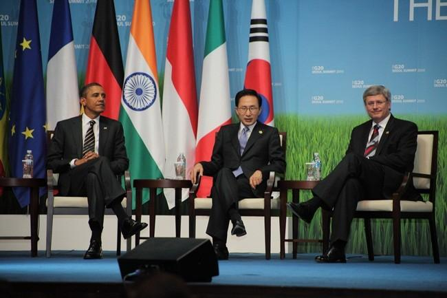 U.S. President Barack Obama (left), South Korean President Lee Myung-bak (center), and Canadian Prime Minister Stephen Harper sit during an awards presentation for small and medium sized businesses after the end of meetings at the G20 Seoul Summit on Nove