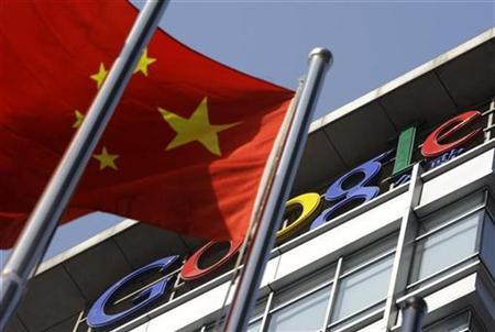 A Chinese national flag sways in front of Google China's headquarters