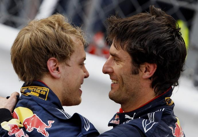 Red Bull Formula One driver Webber of Australia celebrates with his teammate Sebastian Vettel of Germany, who finished, after winning the Monaco F1 Grand Prix on 16/05/2010.