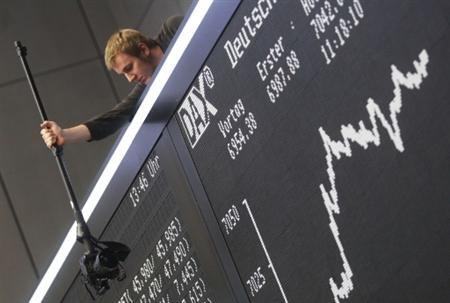 Photographer takes pictures of the DAX board at the Frankfurt stock exchange