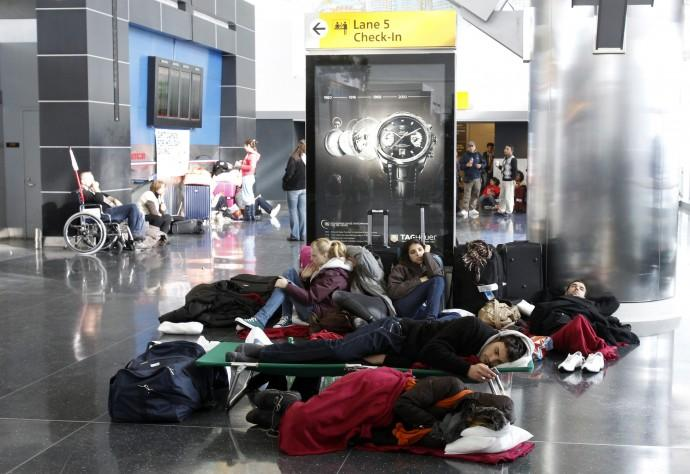 Passengers stranded at JFK International Airport wait for the airport to reopen in New York
