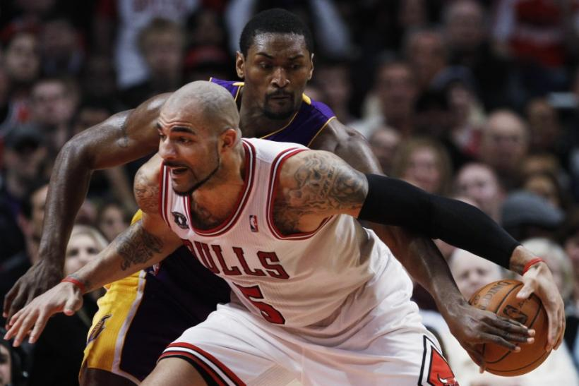Chicago Bulls Carlos Boozer and Los Angeles Lakers Ron Artest battle for control of the ball in Chicago.