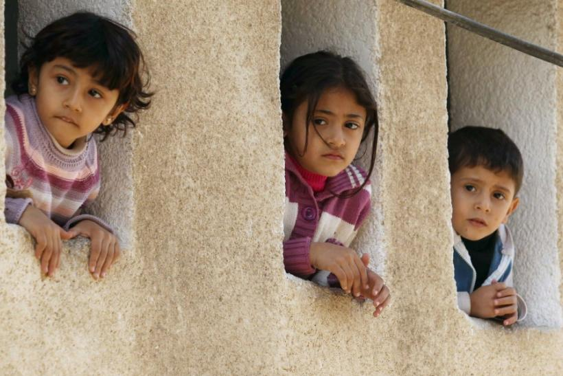 Palestinian children watch the funeral of Islamic Jihad militant Jalal Nasir in Jabalya, in the northern Gaza Strip