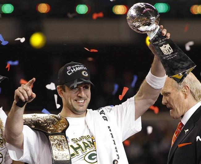 Green Bay Packers MVP quarterback Aaron Rodgers celebrates with the Vince Lombardi trophy after the Packers defeated the Pittsburgh Steelers in the NFL's Super Bowl XLV football game in Arlington, Texas, February 6, 2011. Rodgers was voted MVP of the game