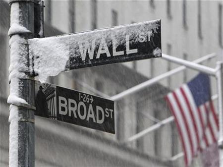 Snow covers a street sign at the corner of Wall St. and Broad St. in New York's financial district