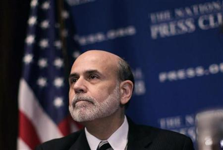 Chairman of the Federal Reserve Ben Bernanke attends a National Press Club luncheon on the economic outlook in Washington