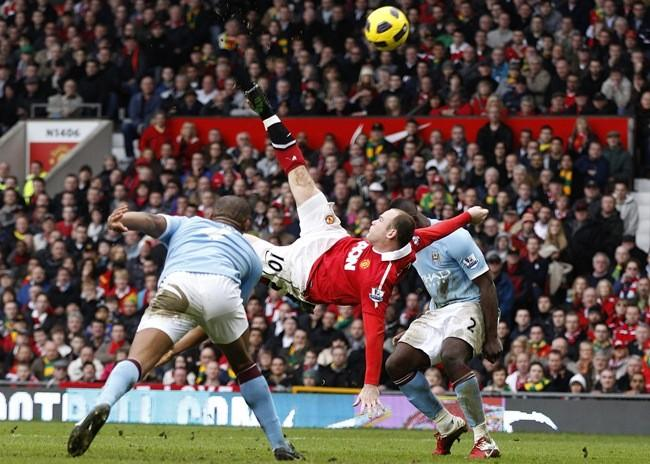 Manchester United's Wayne Rooney scores against Manchester City from an overhead kick during their English Premier League soccer match at Old Trafford in Manchester, northern England, February 12, 2011.