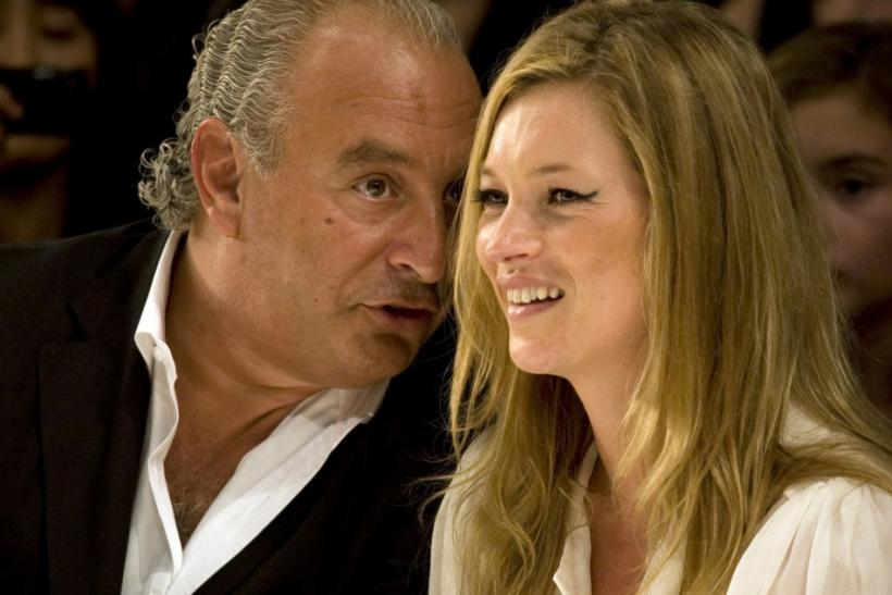 Super model Kate Moss and Top Shop owner Philip Green watch the Fashion for Relief charity fashion show in London