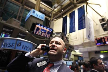A trader talks on the phone on the floor of the New York Stock Exchange