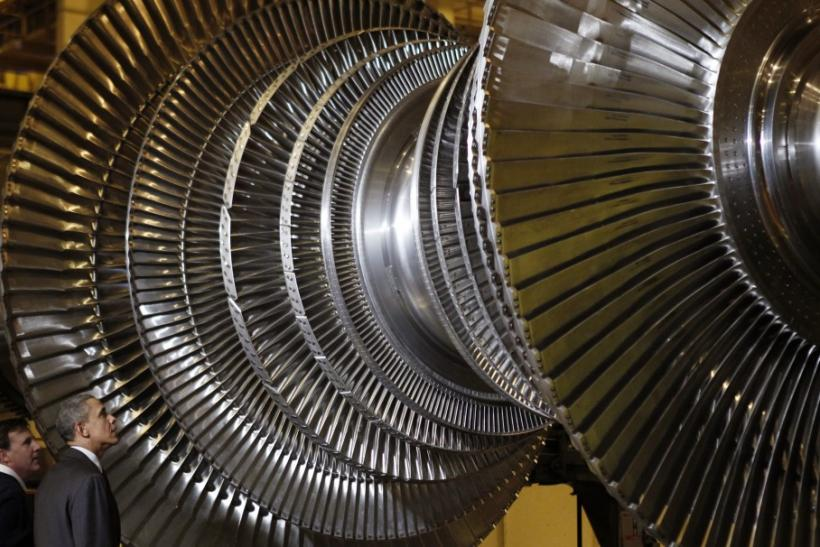 U.S. President Barack Obama views a turbine as he tours General Electric's birthplace in Sche