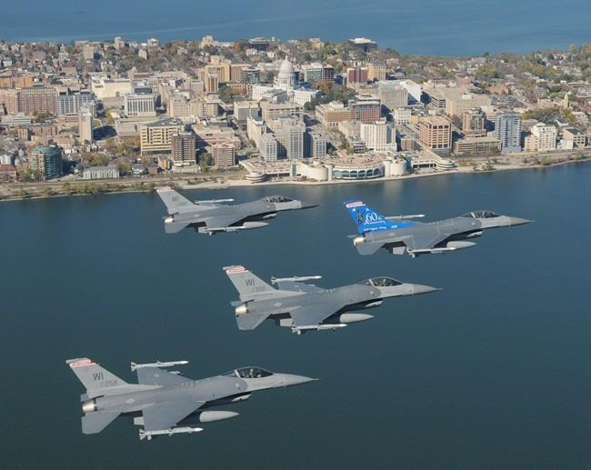 Four F-16C Fighting Falcons from the 115th Fighter Wing, Wisconsin Air National Guard fly over Wisconsin's capital city of Madison during a routine training mission, in this October 18, 2008 file photo.