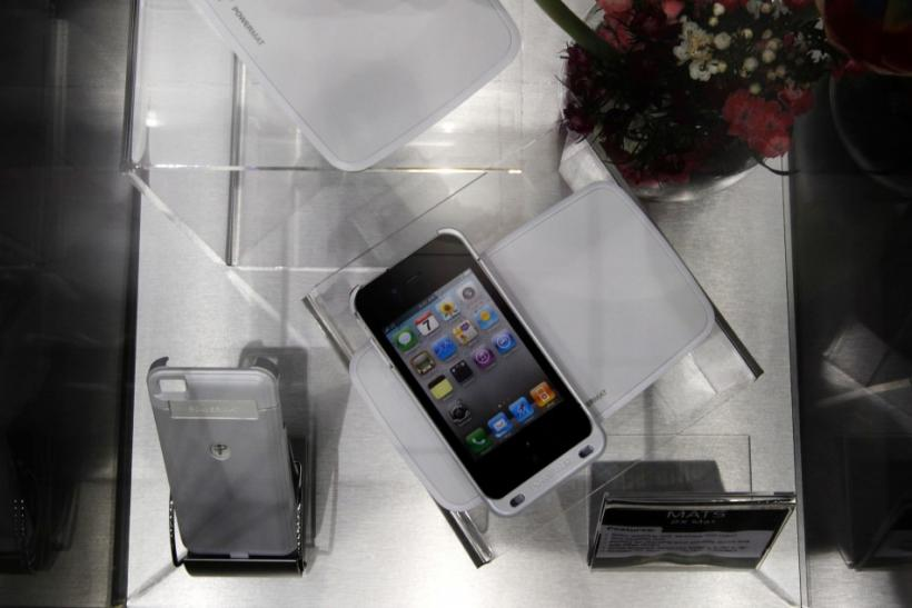 A Powermat wireless charging system is displayed as charging an Apple's iPhone 4 during the GSMA Mobile World Congress in Barcelona.