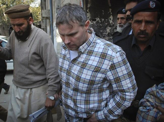 U.S. consulate employee Raymond Davis is escorted by police and officials out of court after facing a judge in Lahore, January 28, 2011.