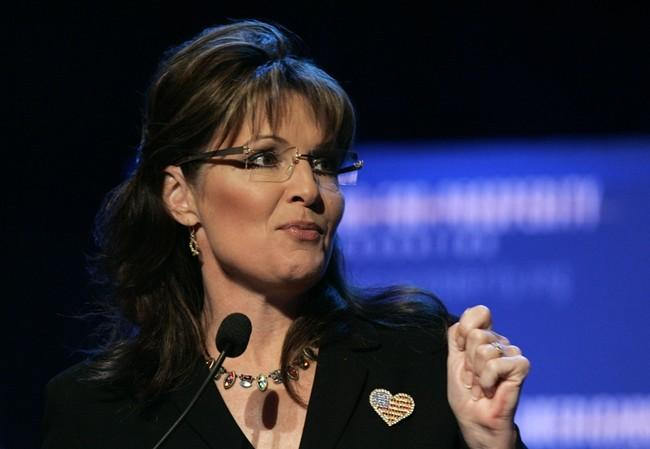 Former Alaska Governor and 2008 Republican Vice Presidential candidate Sarah Palin addresses the audience during the 'Americans For Prosperity Foundation Summit' in Clarkston, Michigan May 1, 2010.