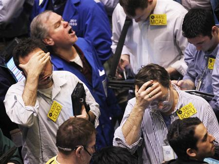Traders work in the oil options pit on the floor of the New York Mercantile Exchange in New York City